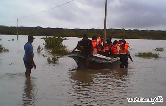 After 'Mandagal Aru' Bridge Closure, Troops Facilitate Passage Using Boats