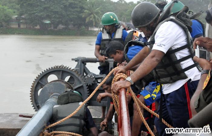Troops Open Jammed Sluice Gate Averting Catastrophe