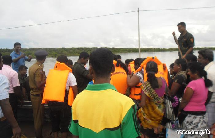 Troops Ferry Stranded Civilians Across Mandagal Aru Bridge