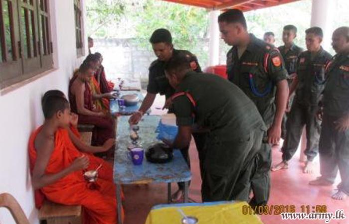 SLNG Troops Offer Alms