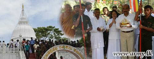 Commander Takes Part in 'Poson' Religious Observances