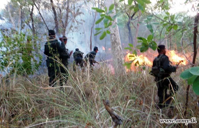 18 GW Troops Douse Bush Fire