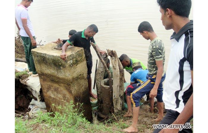 Troops Avert Tank Bund Split in Palampiddi