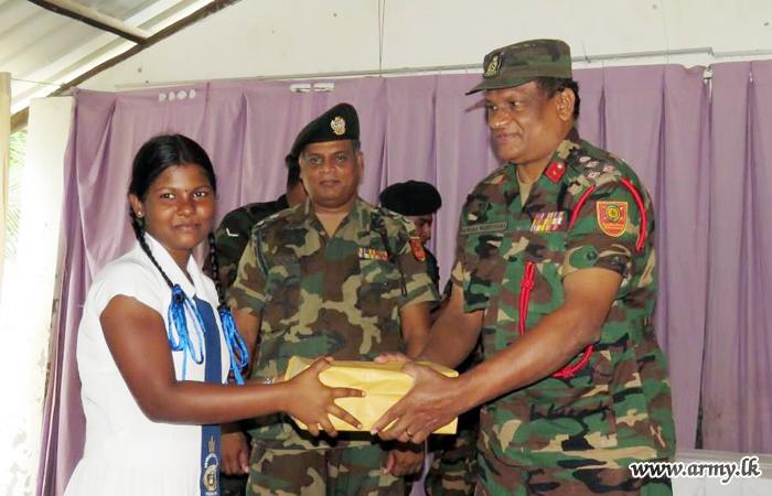 Expatriate's Organization Gives Shoes & Kitchen Utensils Thru Army Coordination