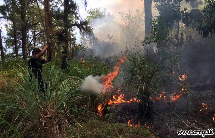Troops Extinguish Fire on Knuckles Range