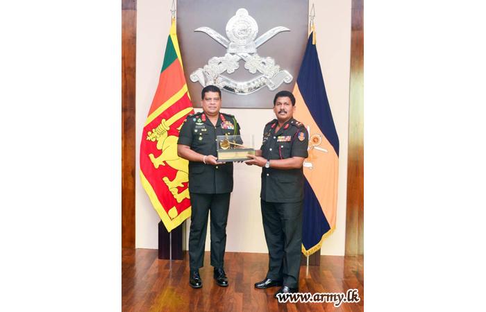 Commander Appreciates Retiring QMG's Dedicated Services Inviting Him