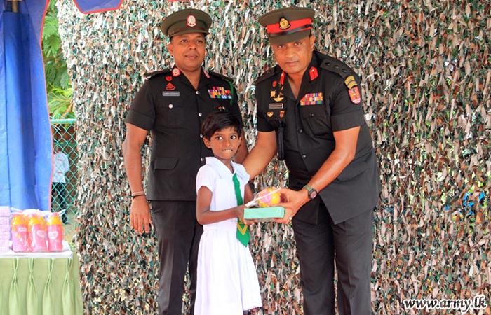 Troops Buy School Accessories for Children in Muhamalai School