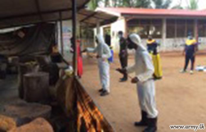 Troops Sterilize Public Places in Mullaittivu against COVID - 19 Threat