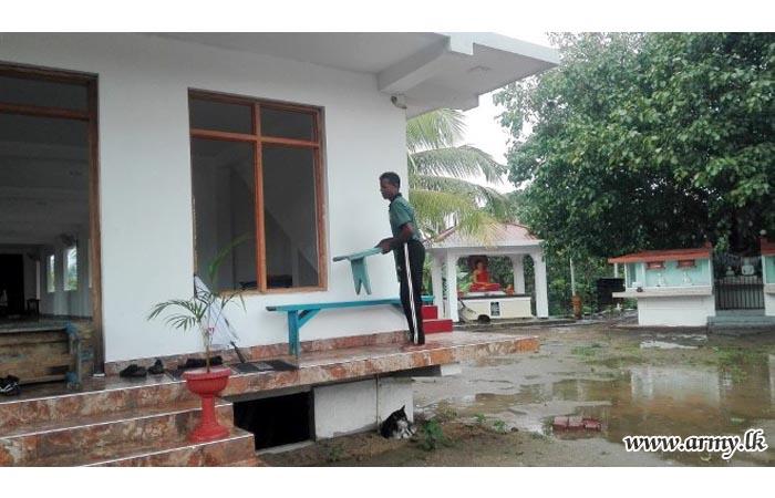 SFHQ-C Troops Conduct 'Shramadana' to Clean Temple Premises